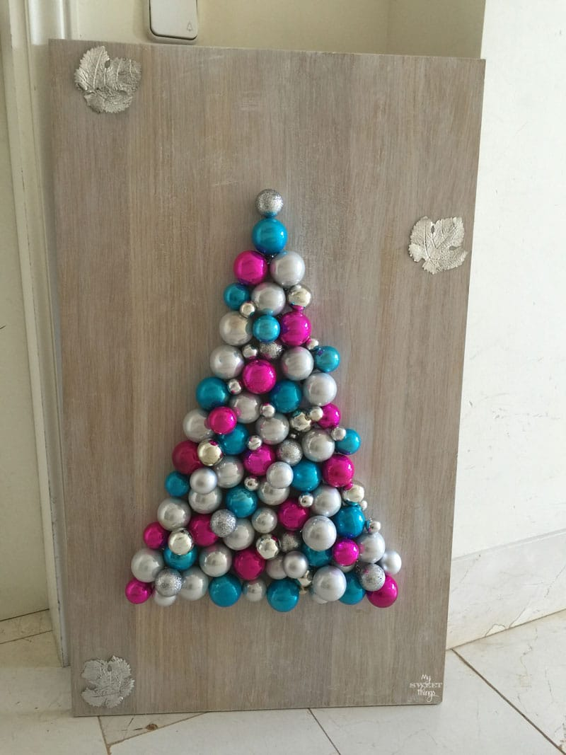 Take some scrap wood and Christmas baubles to make an alternative Christmas tree | DIY | Via www.sweethings.net