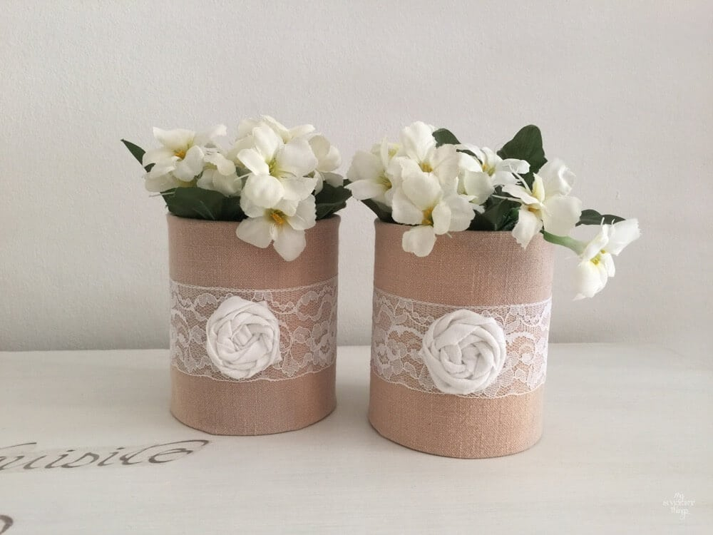 Fabric wrapped tins to get some pretty vases, and easy and cheap DIY