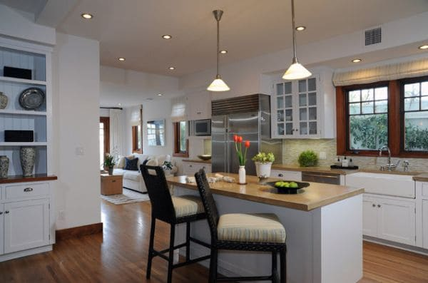 Dreamy kitchens with lovely barstools  ·  Kitchen island with seating    ·  Open floor plan kitchen   ·  Via www.sweethings.net