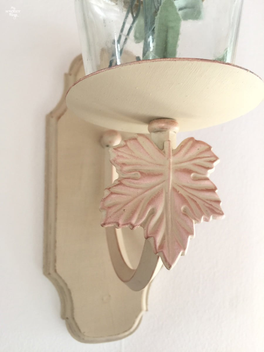Light wall sconce repurposed into candle wall sconce with just some paint and an empty jar · Via www.sweethings.net