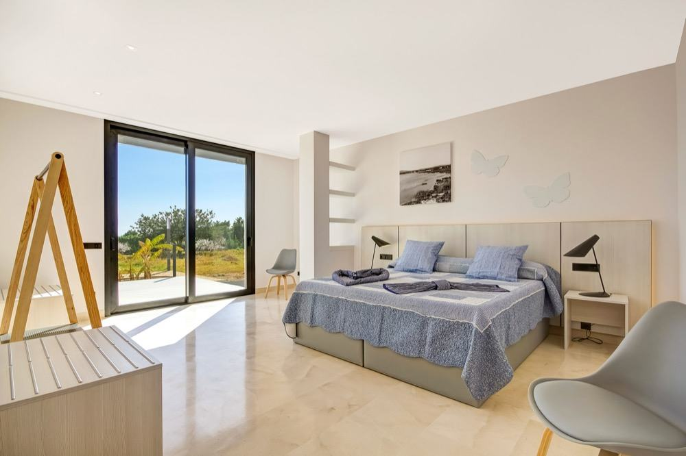 Modern property with sea views which has a bright and airy look · Large bedroom with sea views · Via www.sweethings.net