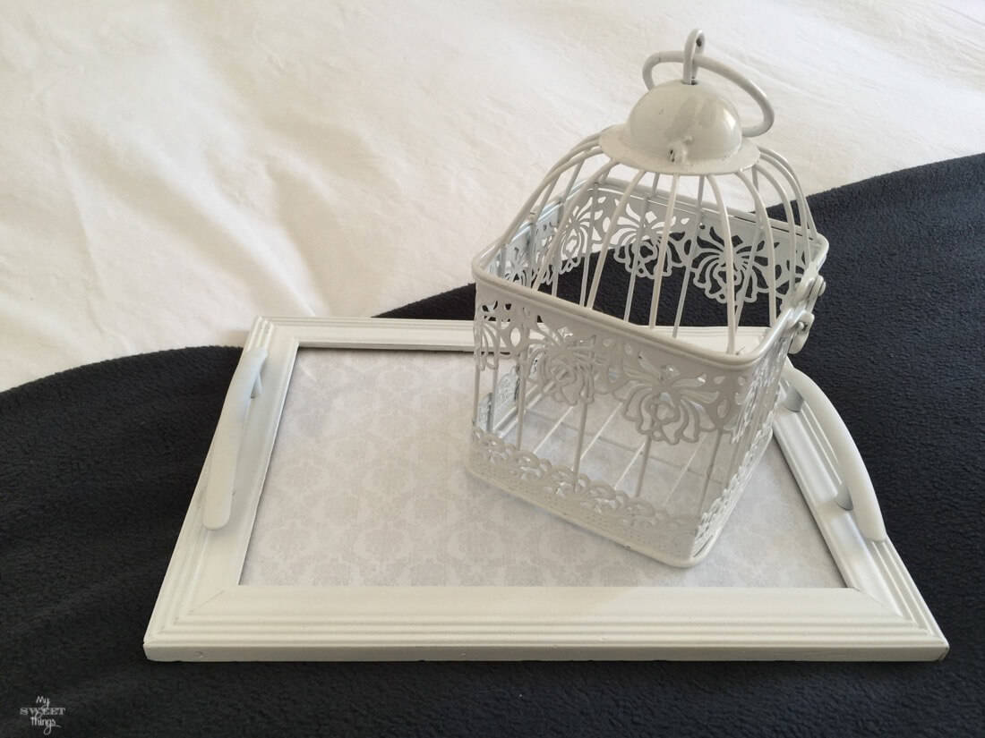 How to get a bright look in your bedroom on a budget, add little details such a cage or a small tray · Via www.sweethings.net
