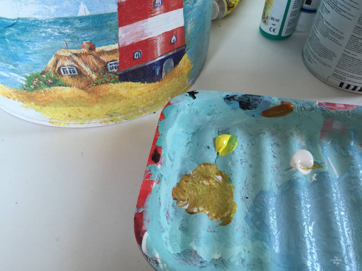 Coffee tin turned into nautical vase with paint and decoupage  ·  Via www.sweethings.net