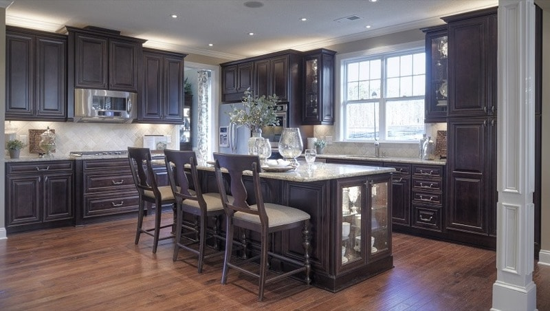 Traditional kitchen with granite countertops black wood cabinets   My Sweet Things