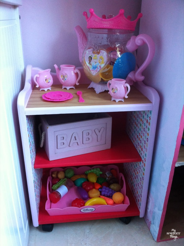Cabinet found curbside was transformed into a play kitchen with paint, decoupage and wheels | My Sweet Things