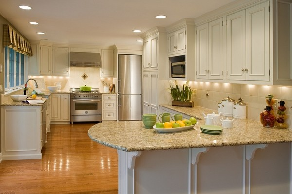 Light granite kitchen countertops with cream wood cabinets   My Sweet Things