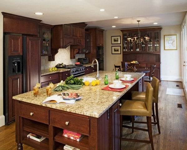Gold granite breakfast bar dark wood kitchen cabinets | My Sweet Things