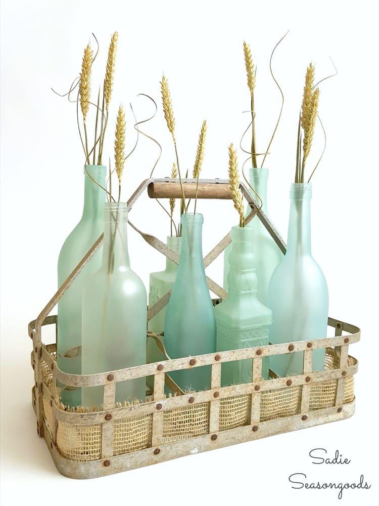 9_vintage_milk_bottle_carrier_basket_repurposed_as_coastal_beach_decor_centerpiece_with_DIY_sea_glass_bottles_Sadie_Seasongoods