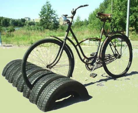 Standing bike rack · 15 Different Uses For Tires · Some easy ideas to recycle old tires · Via www.sweethings.net