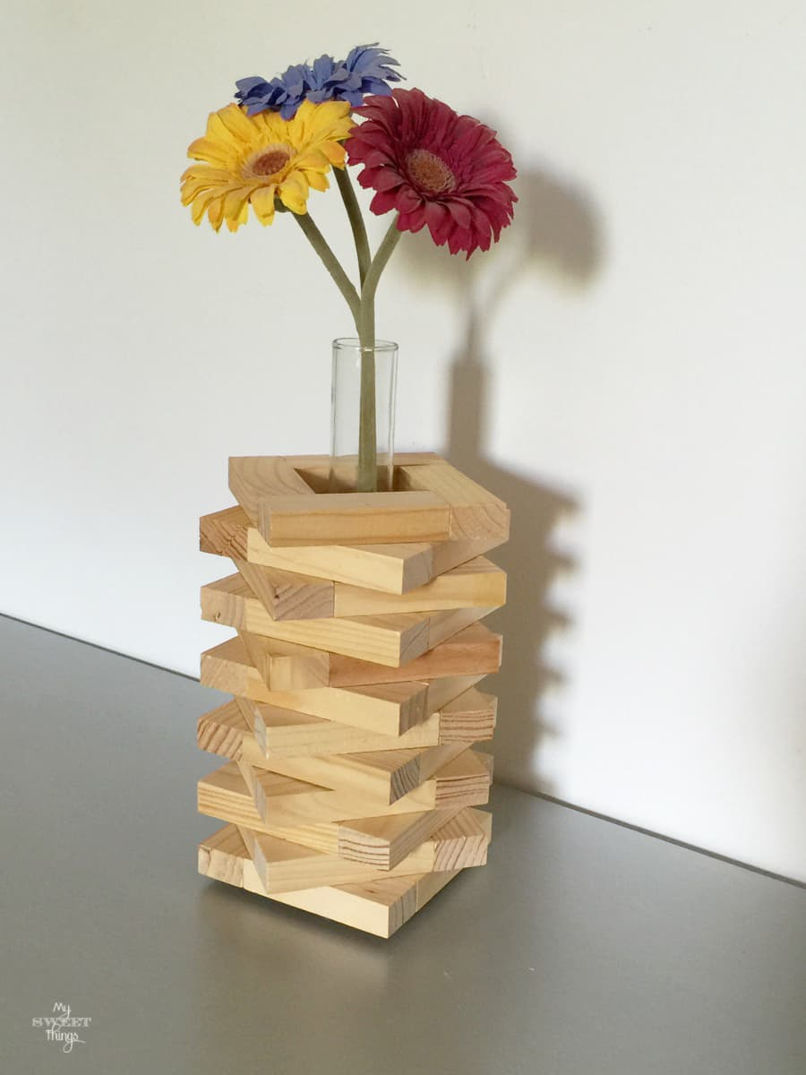 Flower vase out a Jenga game as DIY home decor on the cheap · Via www.sweethings.net