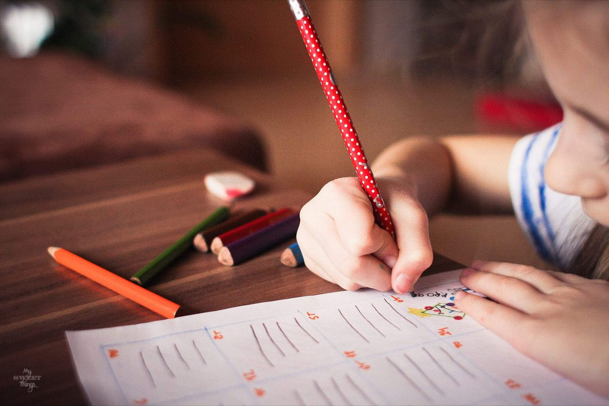 Why Being a Preschool Teacher Can Be a Great Change of Career for a Parent · Kid doing homework · Via www.sweethings.net #parents #studying #career #kids #preschool #teacher