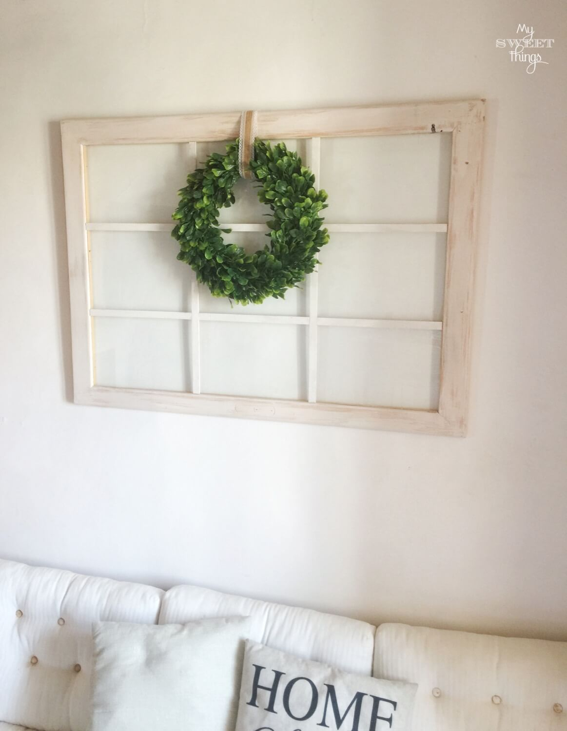 Old windows repurposed into home decor with boxwood wreath · Via www.seethings.net