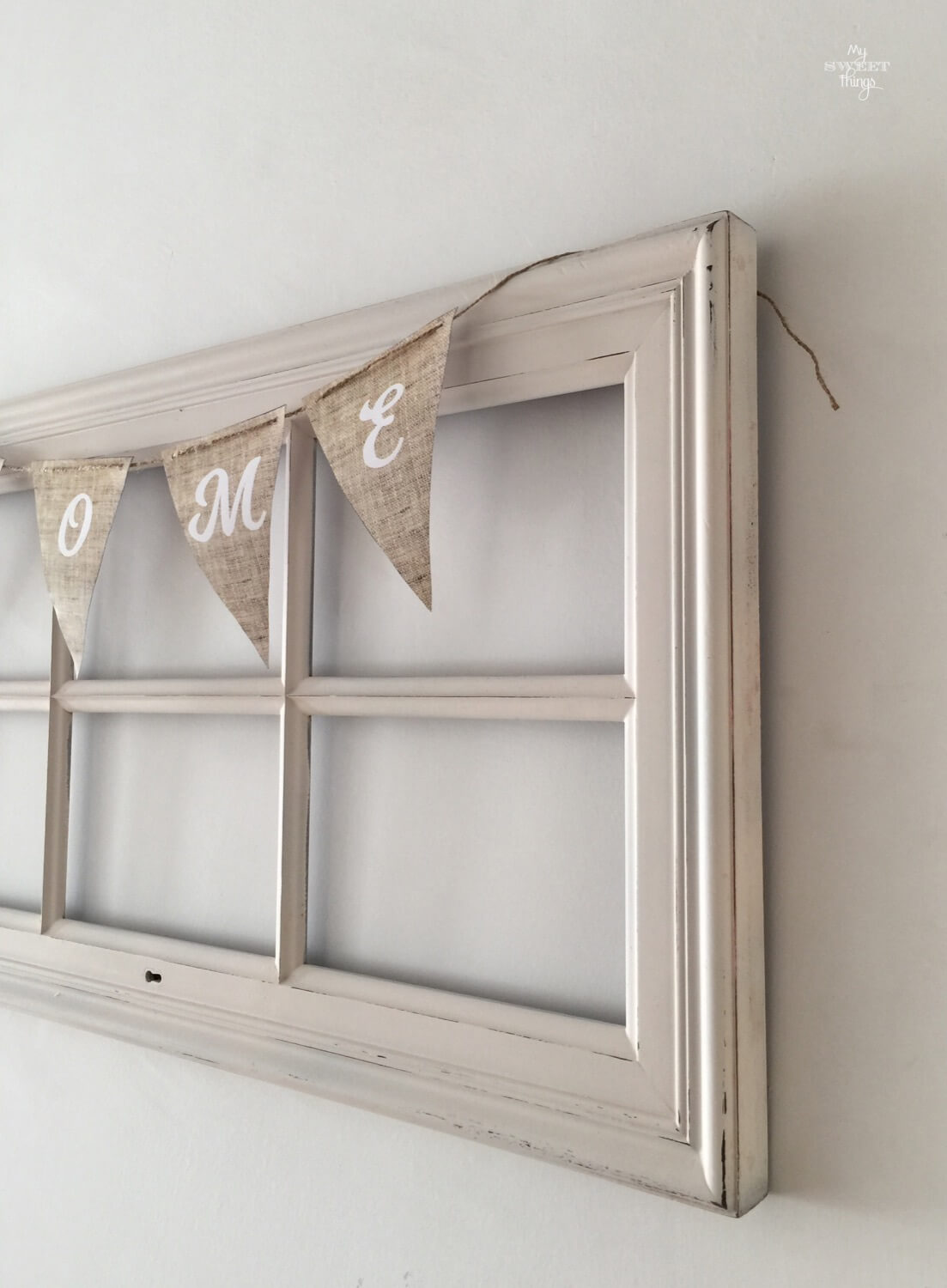 Old windows repurposed into home decor with pennant banner · Via www.seethings.net