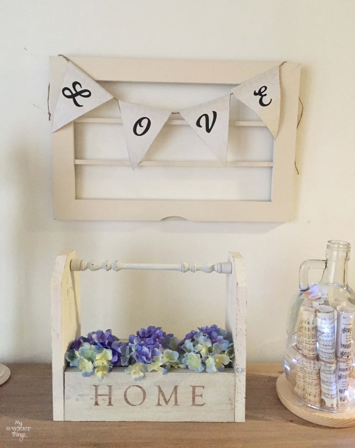 Old window with paper garland · Via www.sweethings.net
